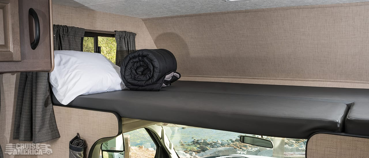 Loft over drivers cab, showing bed arrangement of sleeping gear and cusions