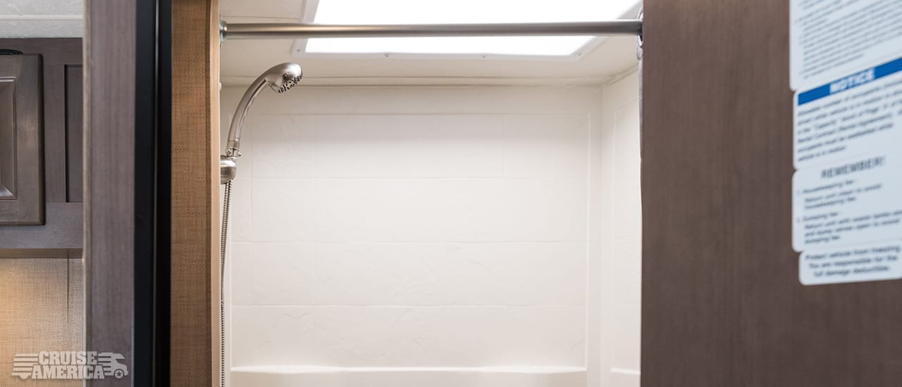 shower stall showing shower head that can be detached and held by hand