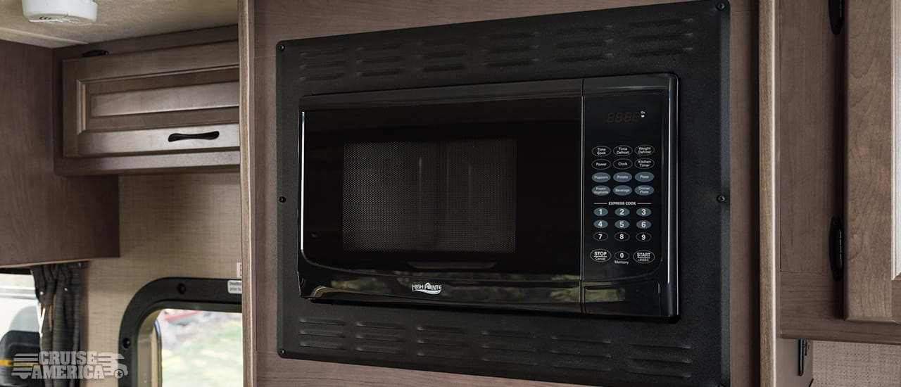 Microwave next to upper cabinet